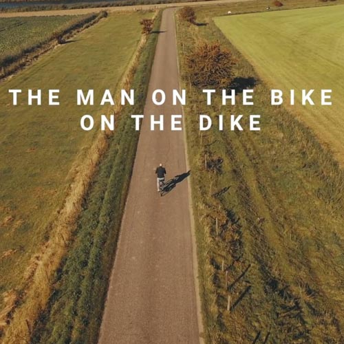 man on the bike on the dike